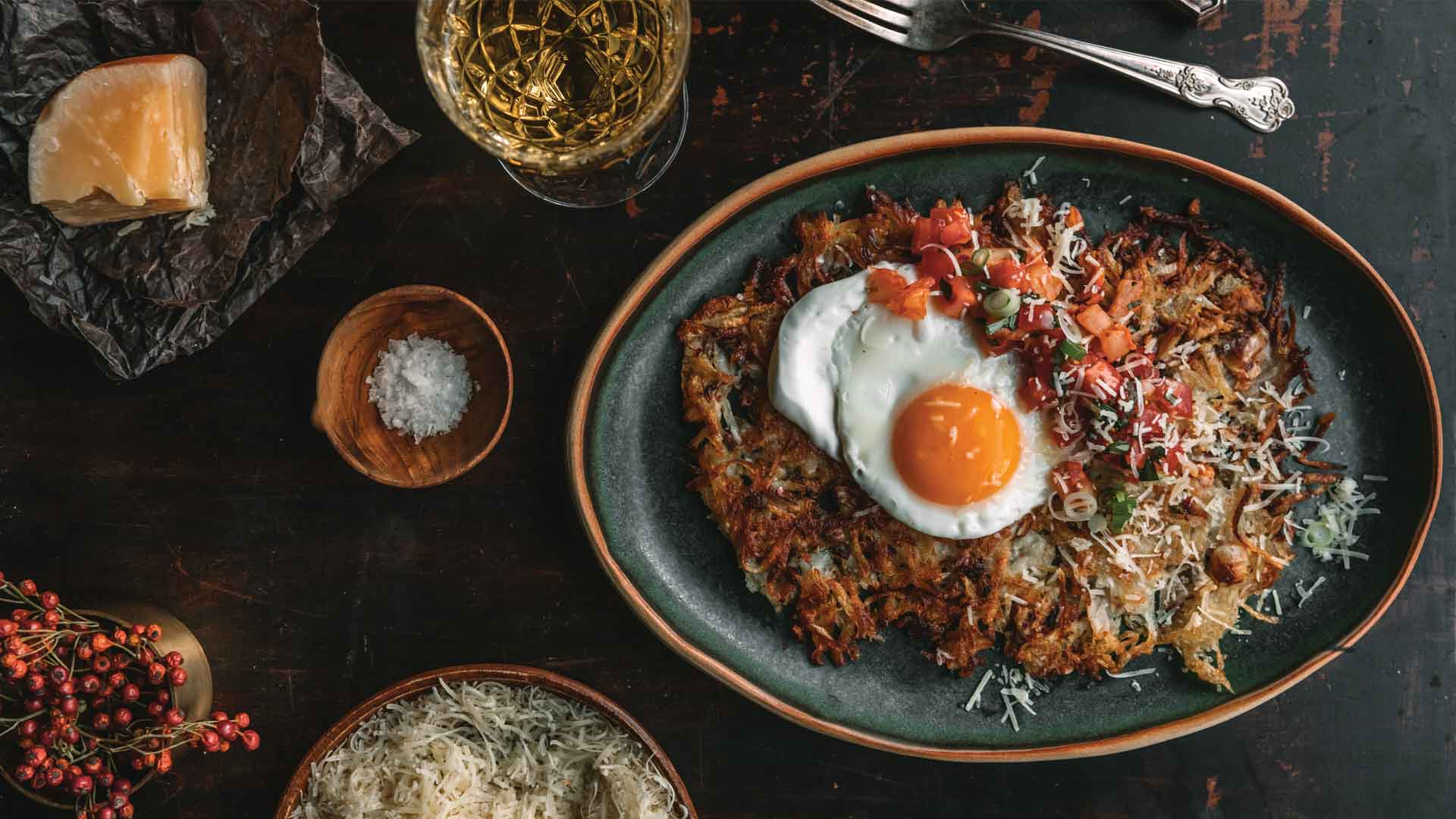 overhead shot of Black dish containing Rosti with fried egg on top